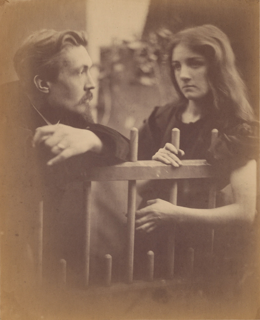 Julia Margaret Cameron:[Young man and woman leaning on a pic,16x12