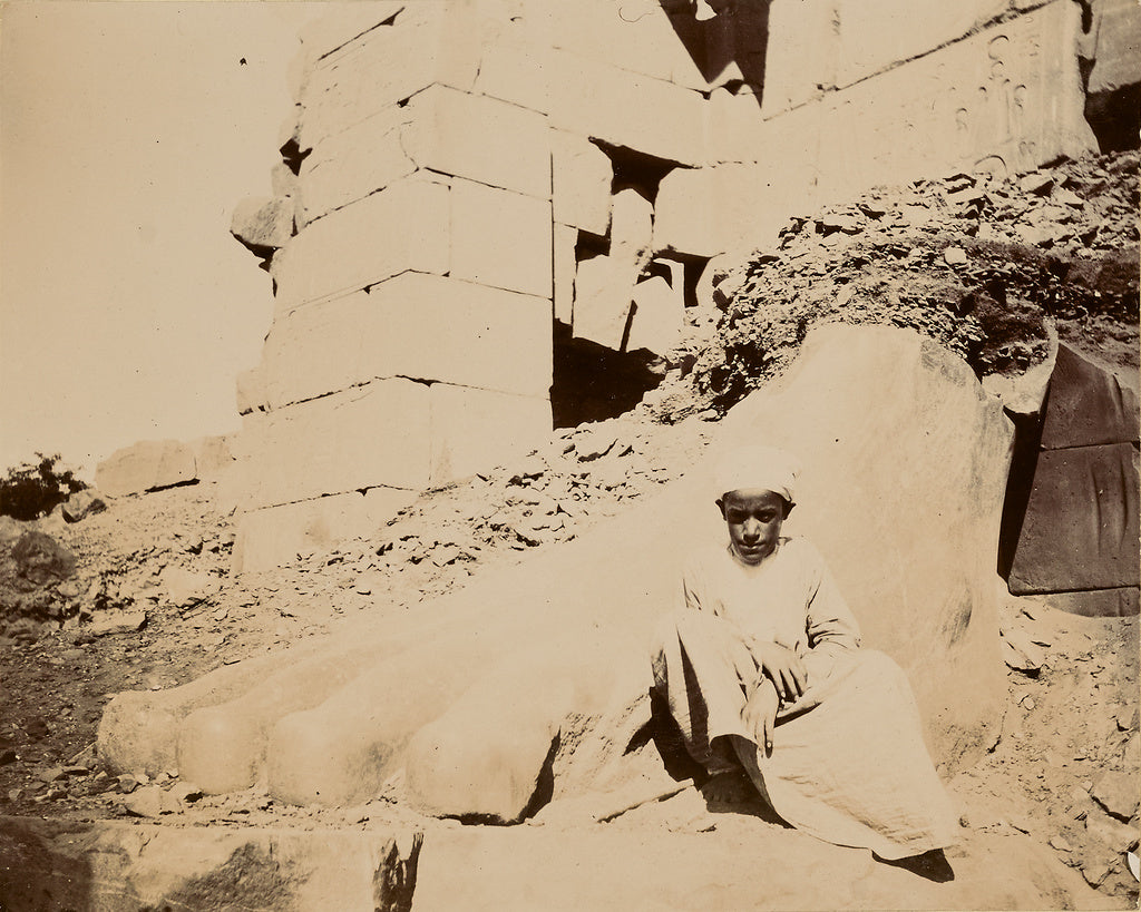 Unknown:[Young man sitting at base of sculptural ruins],16x12