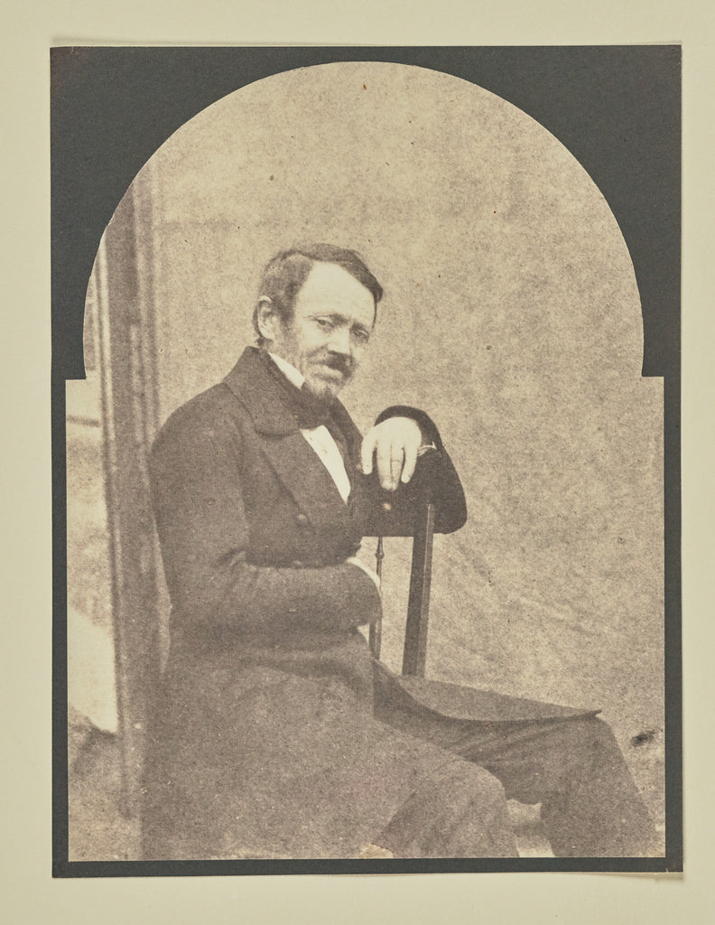 Hippolyte Bayard:[Unidentified man seated before a portable ,16x12