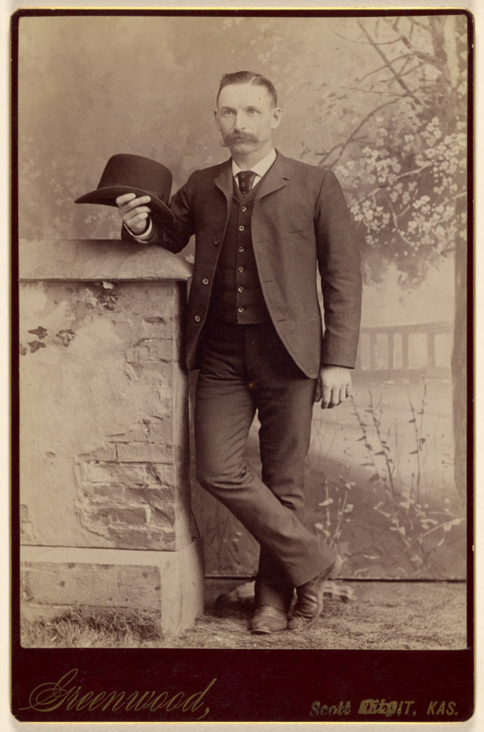 W.H. Greenwood:[Studio portrait of a man holding a hat],16x12