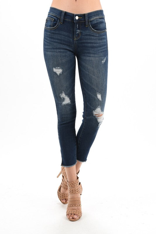 dark blue distressed denim with side slit and raw hem springtime stretch jean