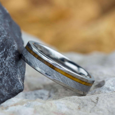 meteorite ring leaning on a rock