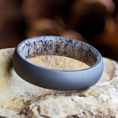 Deer Antler Wedding Band pictured on rock