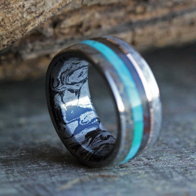 Exotic Wood Wedding Band shown on meteorite backdrop