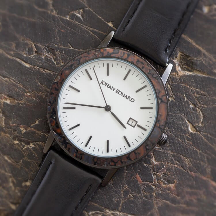 Matte Black Metal Watch With Black Leather Strap, Shown With Dino Bone