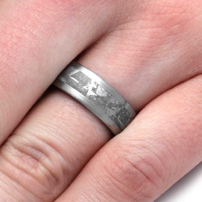 finger wearing Wedding Band With Meteorite And Wood Sleeve