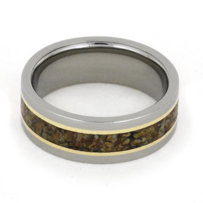 titanium and dinosaur bone ring shown on side