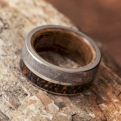 Dinosaur Bone Fossil Ring shown on wood background