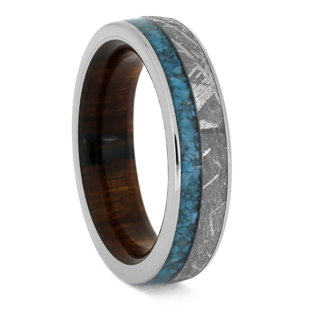 turquoise and meteorite wedding band with wood sleeve showing