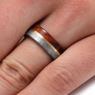 Men's Wood and meteorite ring shown on finger