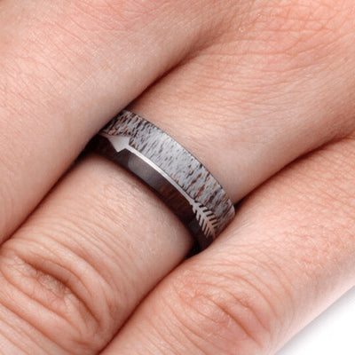 deer antler and wood wedding band on hand