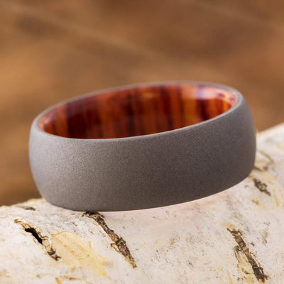 tulipwood wedding band shown on branch