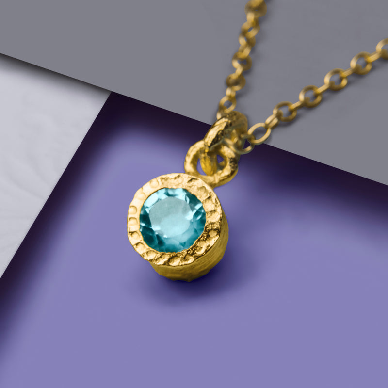 Circular Gold And Blue Topaz Necklace