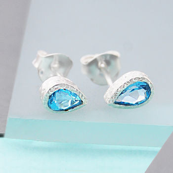 Silver And Blue Topaz Tear Drop Stud Earrings
