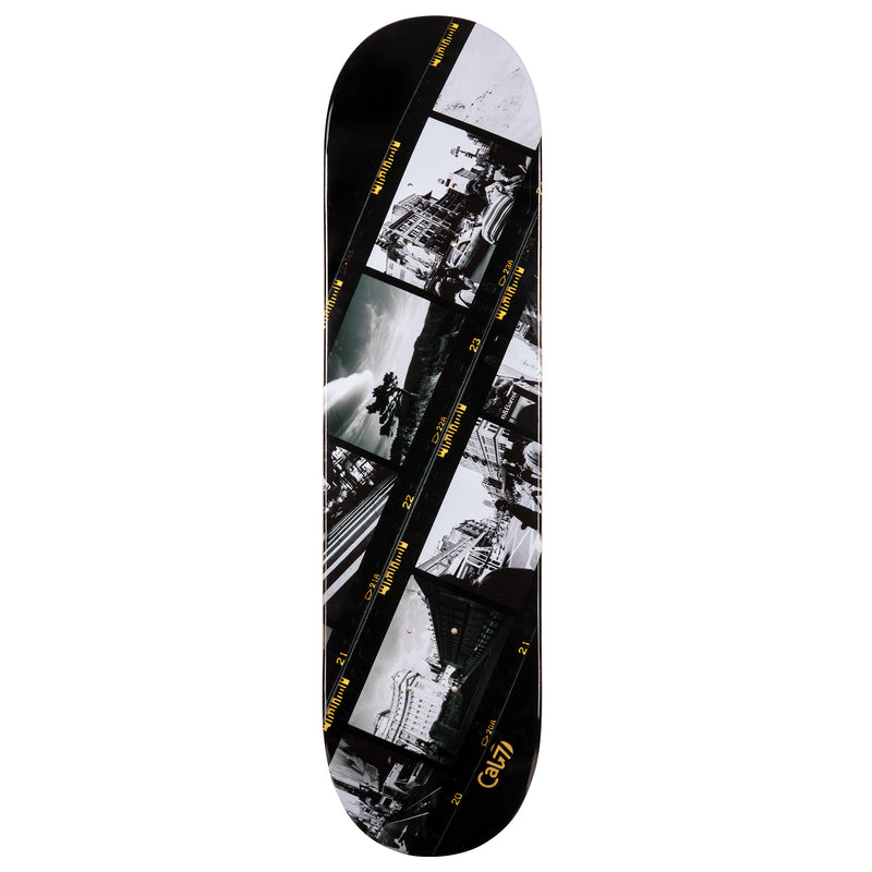 cold pressed cal 7 skateboard deck with negative film graphic