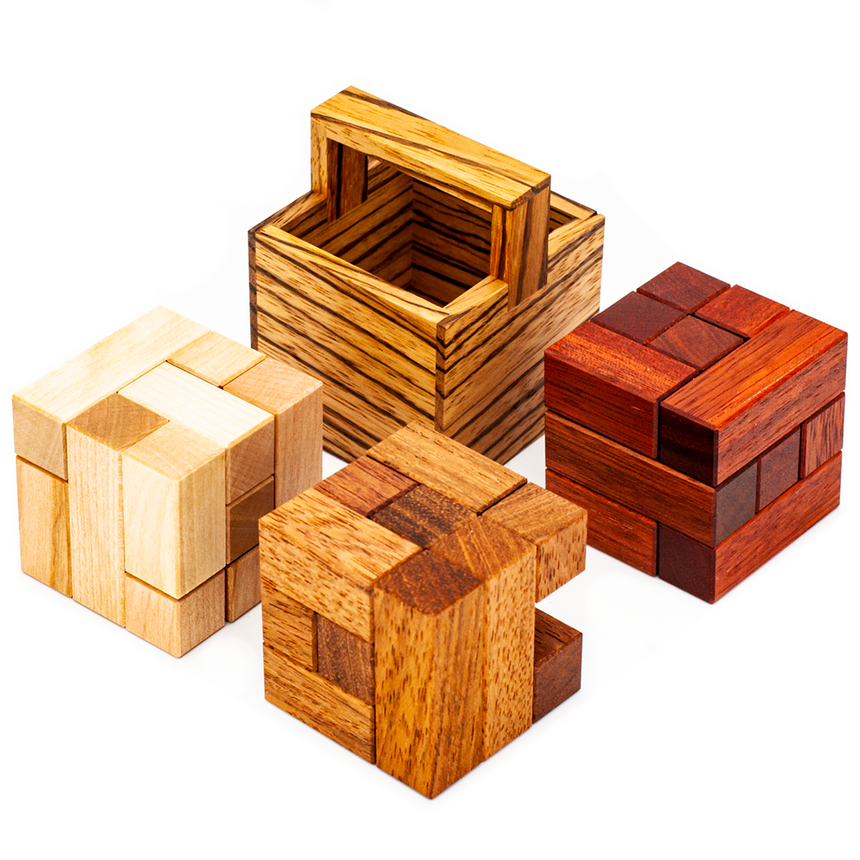 Packing Puzzle, Mechanical Puzzle Boxes, and Puzzle Boxes by Cubic Dissection