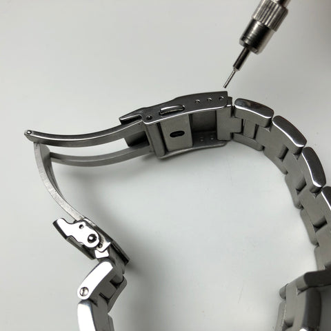 Stainless steel link bracelets can be disconnected here at the clasp