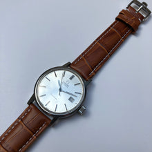 Omega watch with white dial and tan leather strap