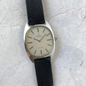 Vintage Omega dress watch with white face and black strap