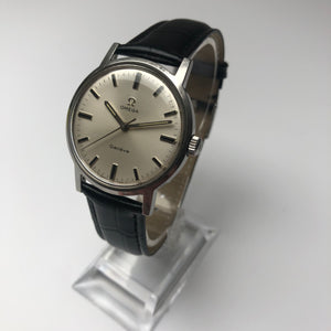 Vintage Omega watch on watch stand