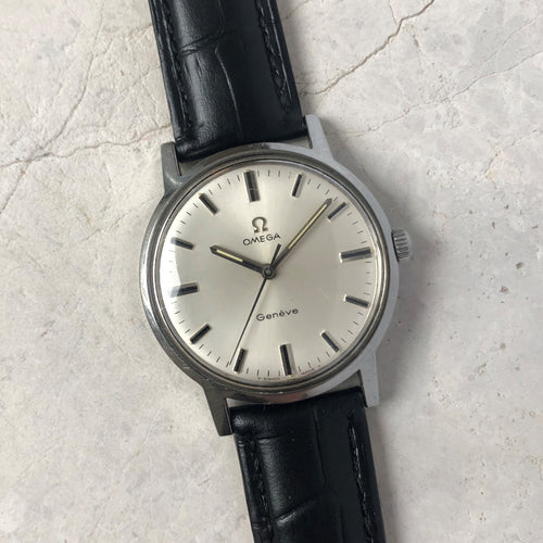 Stainless steel classic Omega watch with white face and black leather strap