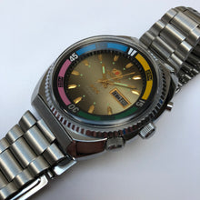 vintage watch with colourful bezel