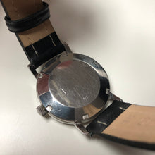 screw-down case back watch