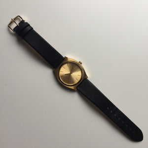 Nixon Time Teller Gold with black leather strap