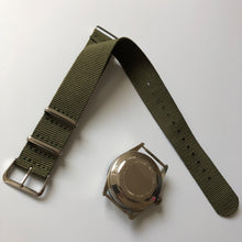 watch and green nylon one-piece strap