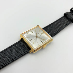Gold watch with lizard strap