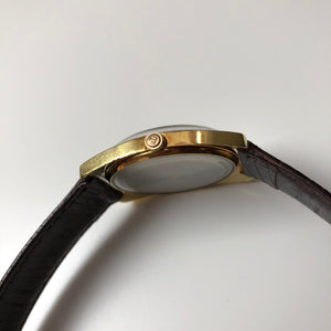 Gold watch on leather strap