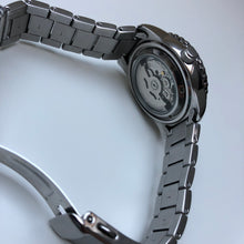 Seiko watch with exhibition case back