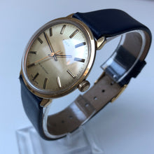 Classic gold watch with blue strap