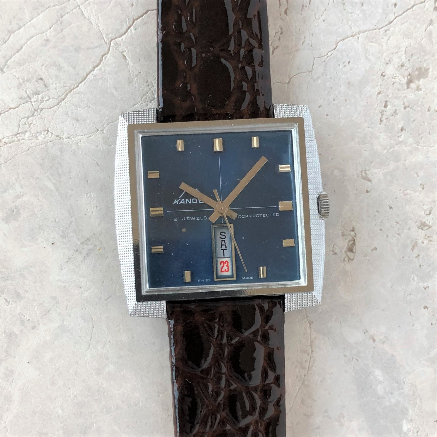 Square shaped blue watch