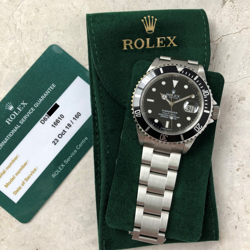Rolex Submariner Date 16610 with Rolex service card