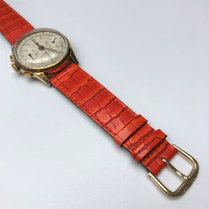 Gold watch with tan leather strap