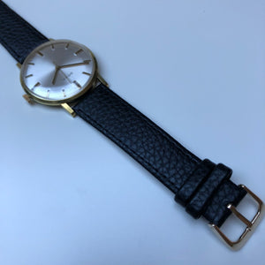 Watch with white dial and black strap