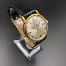 Classic gold watch on presentation stand