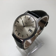 Vintage Omega watch on stand