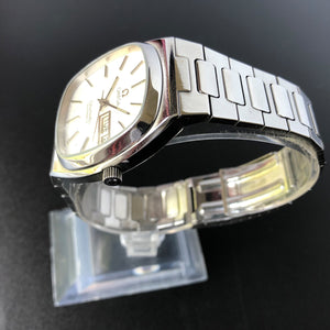 Omega watch on stand