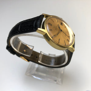 vintage gold omega geneve automatic watch