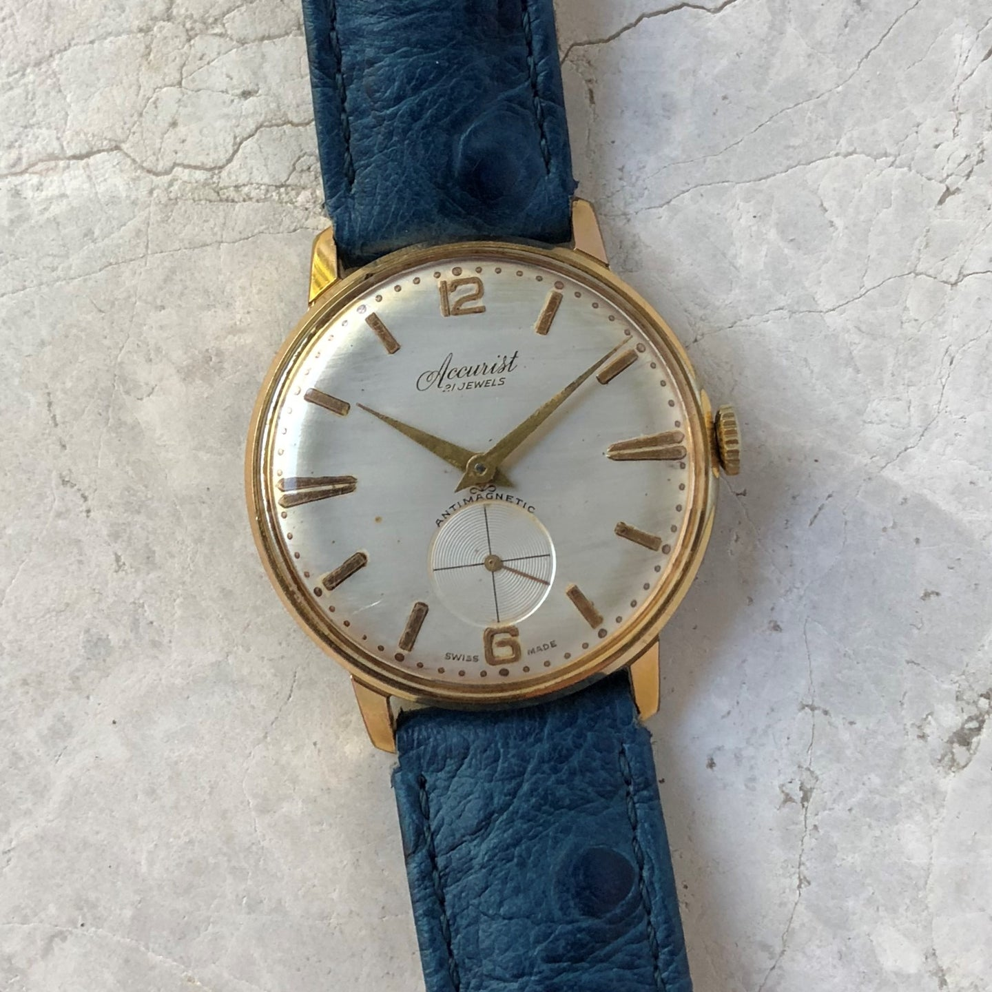 Vintage gold Accurist watch on blue ostrich strap