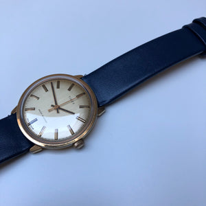 Gold watch with blue strap