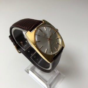Gold Tissot watch