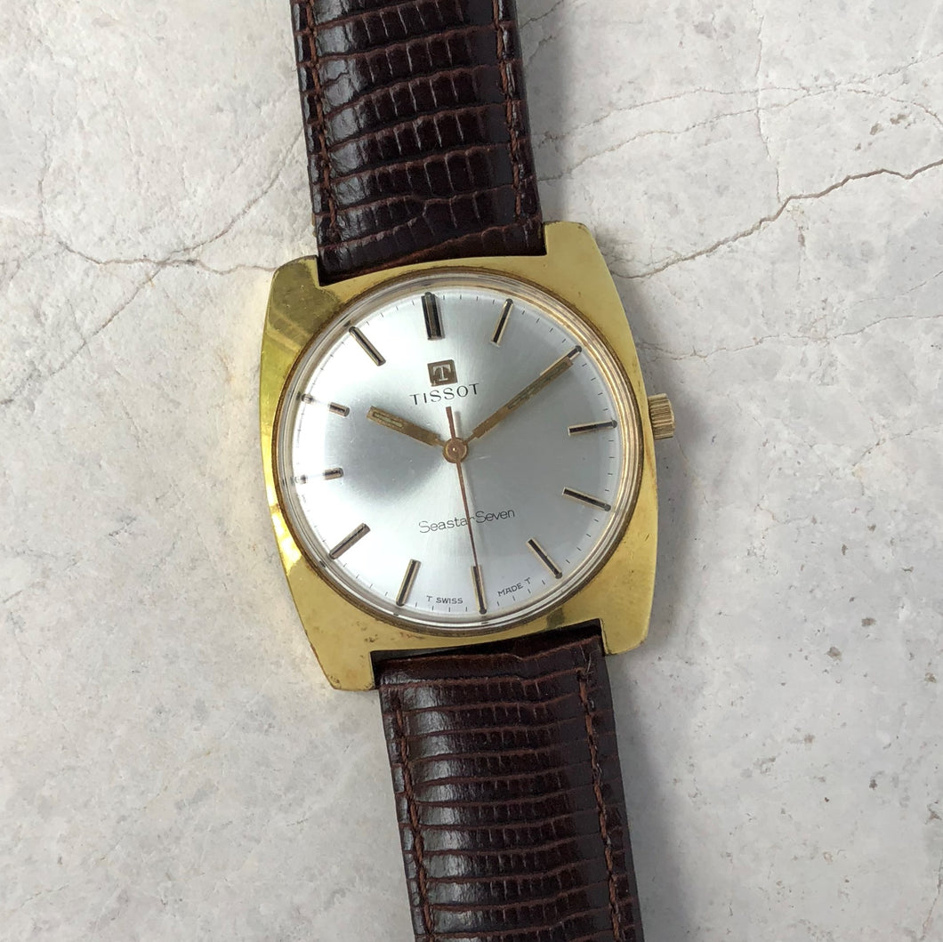 Vintage Tissot gold watch with brown leather strap