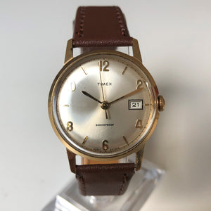 Gold Timex watch