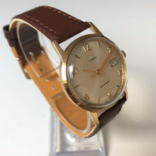 vintage gold watch with brown strap