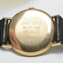 Inscription on case back of gold watch