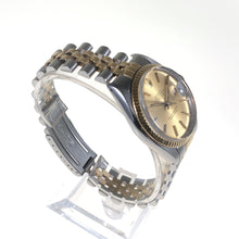 Gold and steel Rolex watch