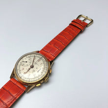 Vintage watch with orange strap